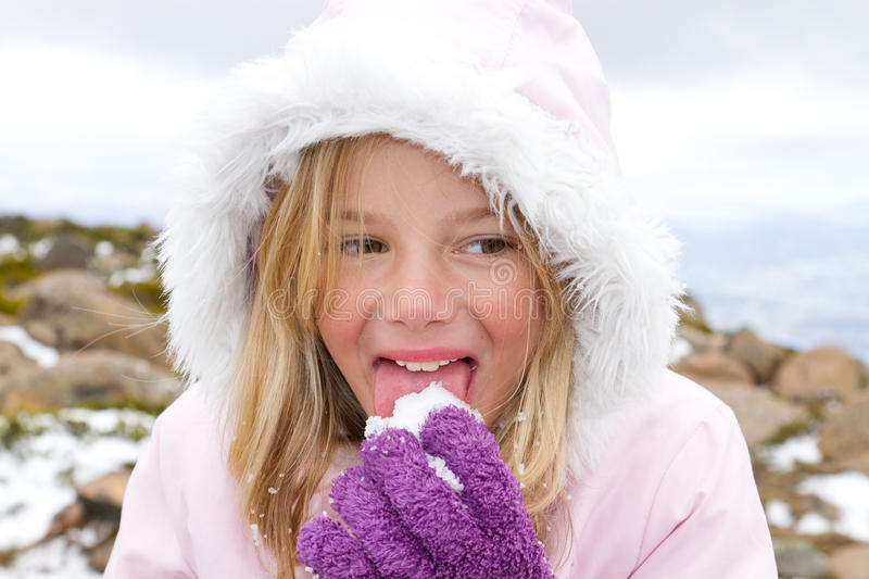 Girl eating snow royalty free stock image
