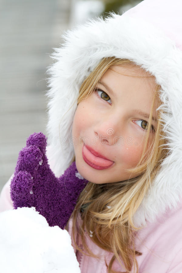 Girl eating snow stock photo