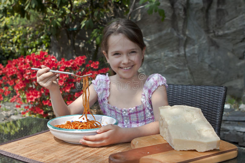 Girl is eating spaghetti royalty free stock photography