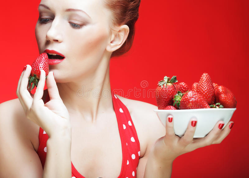 Download Girl eating strawberries stock image. Image of background - 39509319