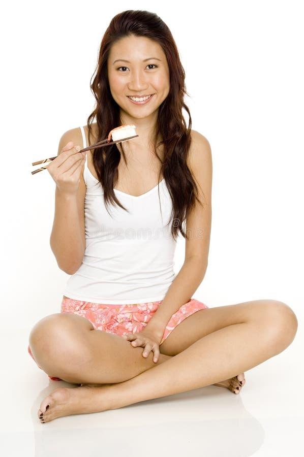 Girl Eating Sushi stock photos
