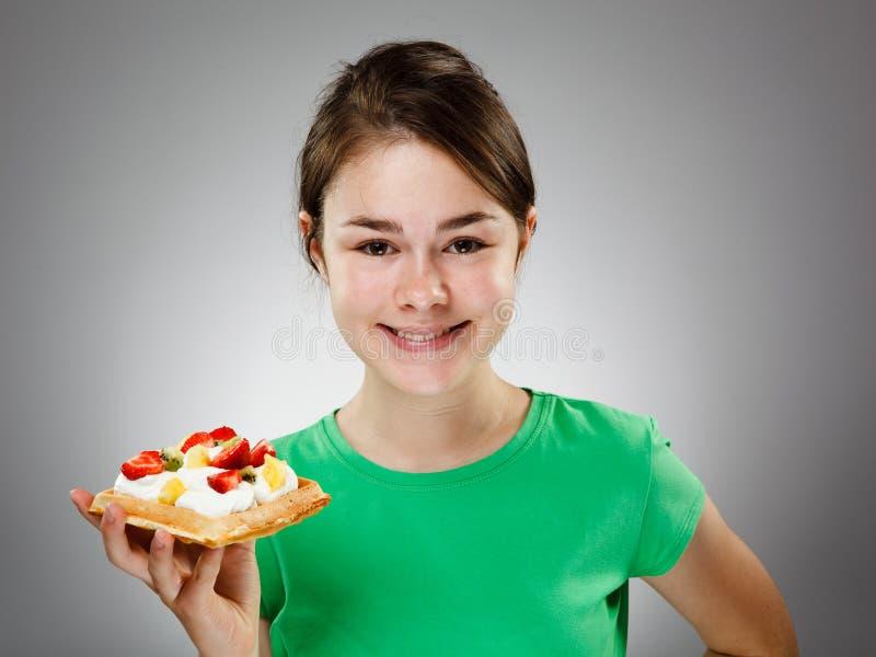 Girl eating waffle stock photos