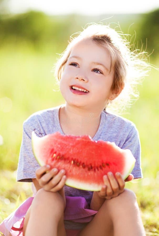 Girl eating watermelon royalty free stock photos