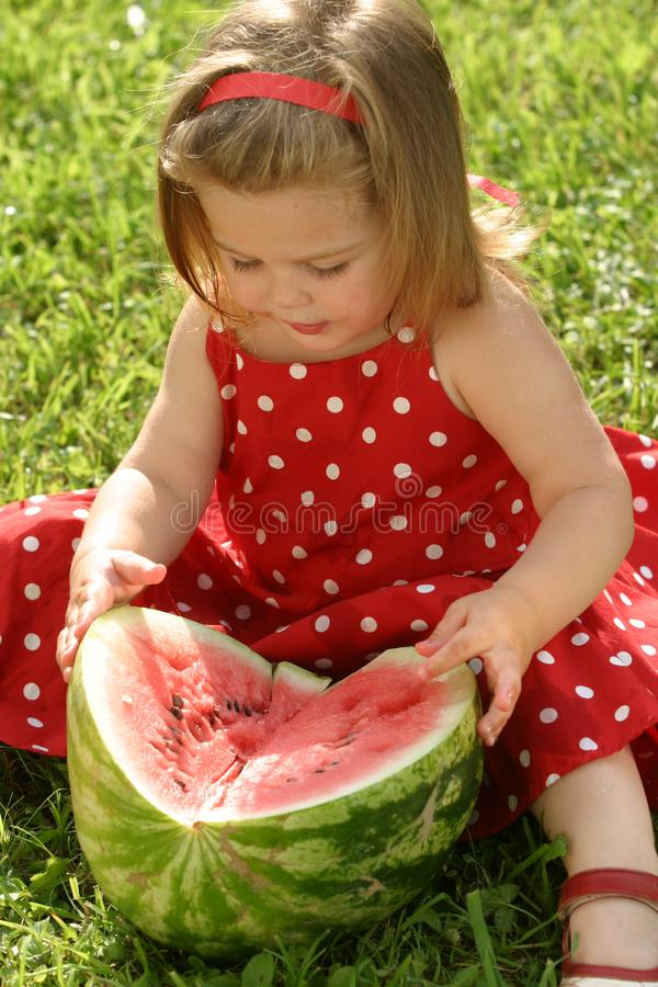 Girl eating watermelon royalty free stock image