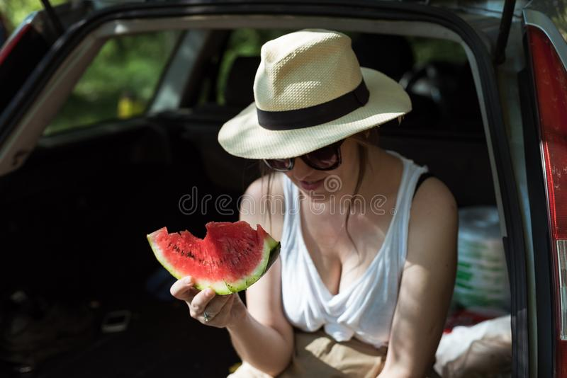 Girl eating watermelon outside stock image