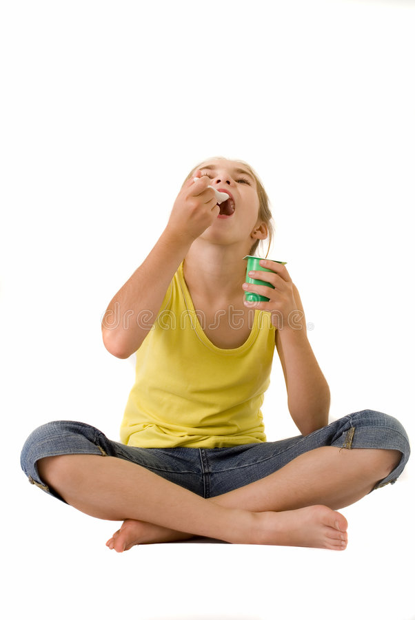 Girl Eating Yoghurt III Royalty Free Stock Photo