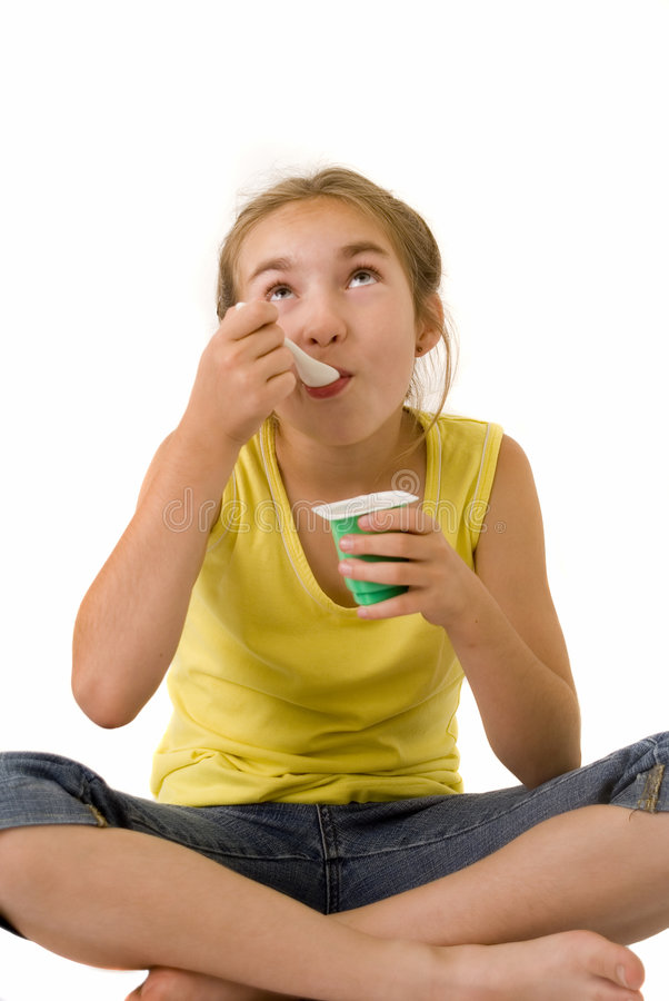 Download Girl eating yoghurt IV stock image. Image of face, food - 2917949