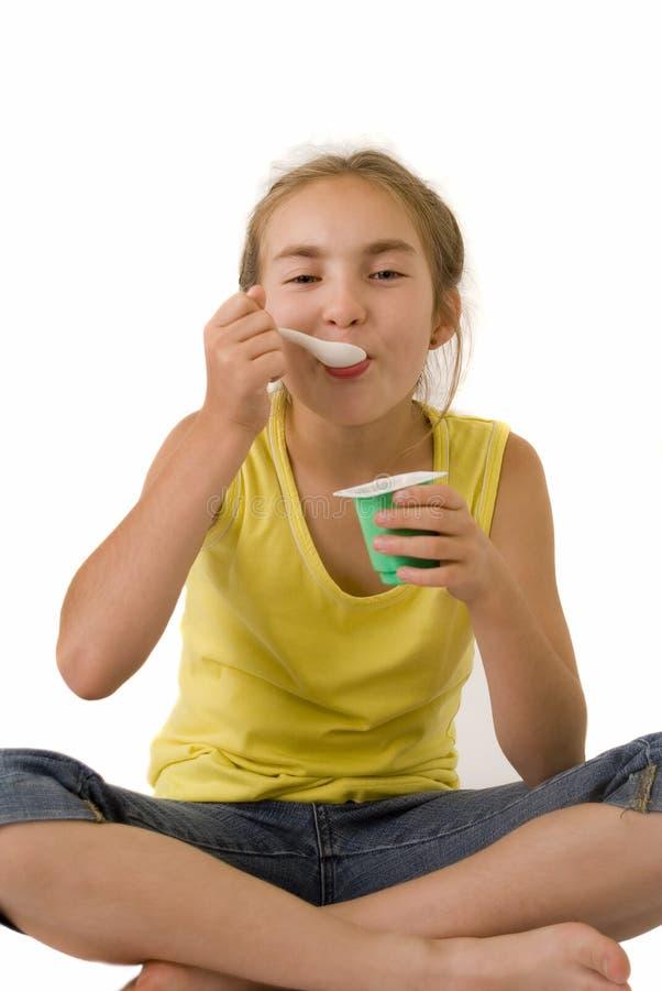 Download Girl eating yoghurt V stock photo. Image of schoolgirl - 2917954