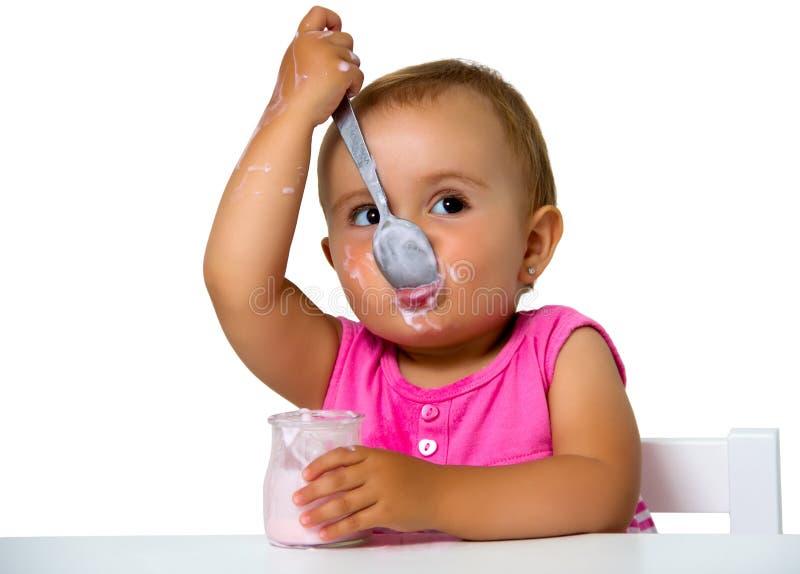 Download Girl Eating Yogurt Royalty Free Stock Image - Image: 33340406