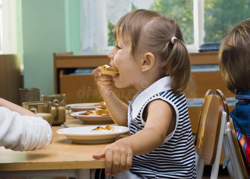 Girl eats stock photography