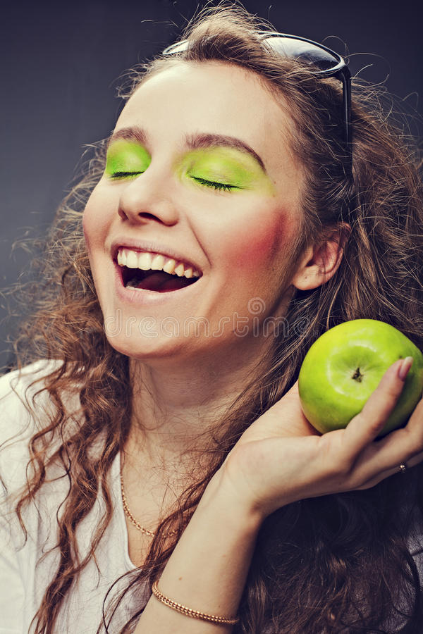 Girl Eats A Juicy Apple Stock Images