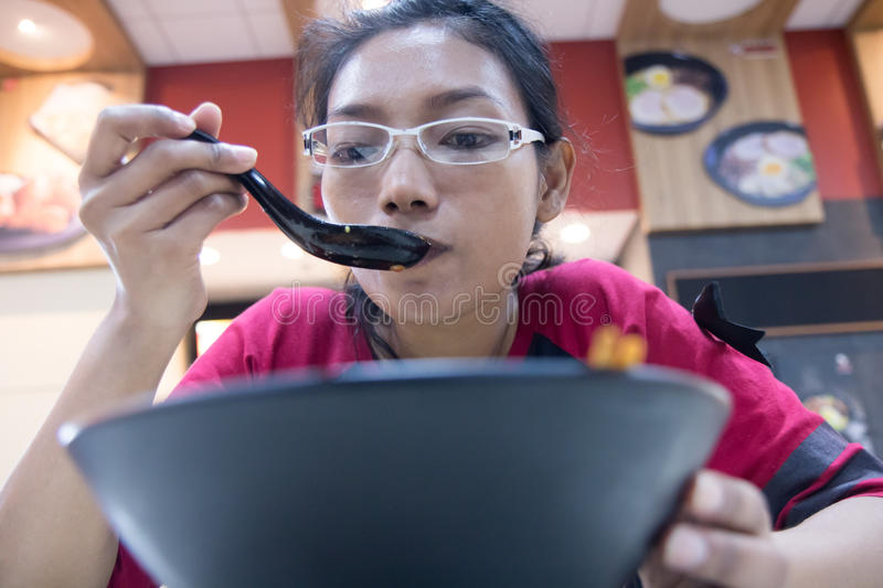 Girl eats lunch from bowl royalty free stock image