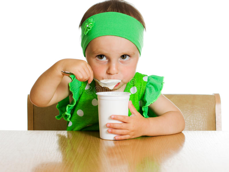 Download Girl Eats With A Spoon Dairy Product. Stock Image - Image: 28072473