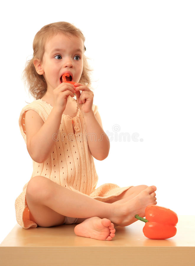 Download Girl eats a sweet pepper. stock image. Image of girl - 11746835