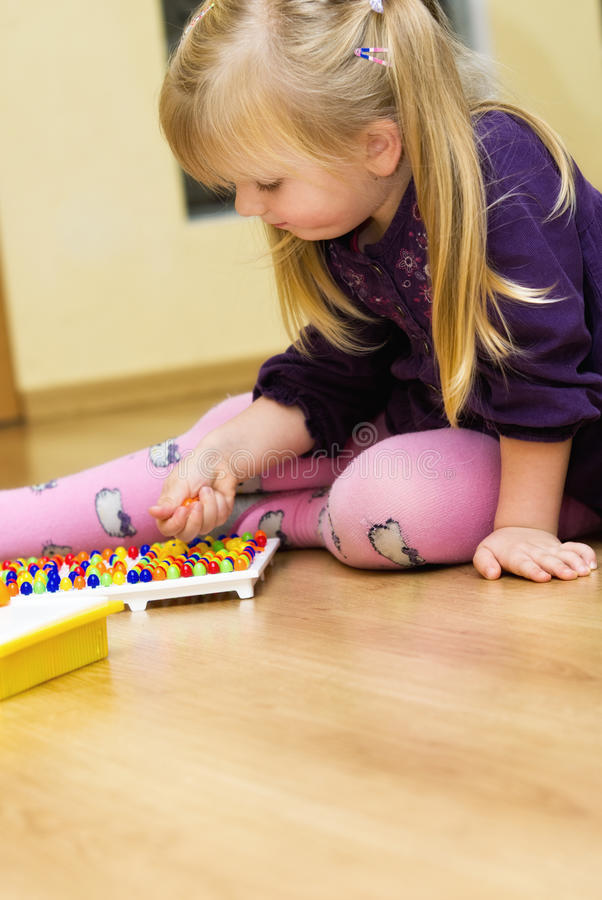 Download Girl With Educational Pin Puzzle Toy Royalty Free Stock Photos - Image: 35552028
