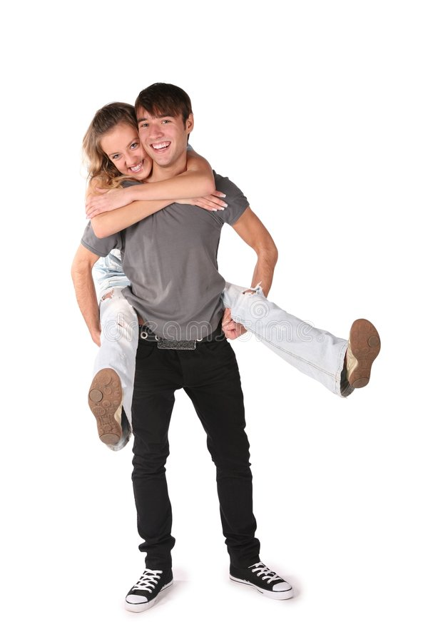 Girl embraces boy from behind stock images