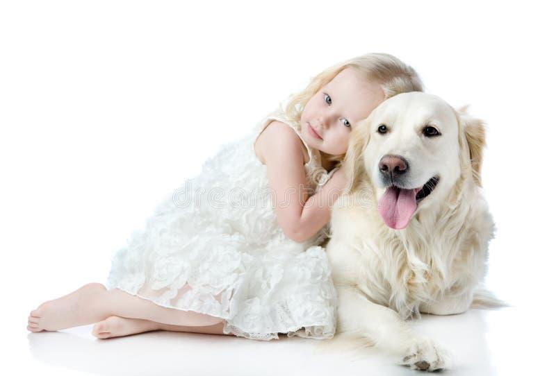 Girl embraces a Golden Retriever. stock images