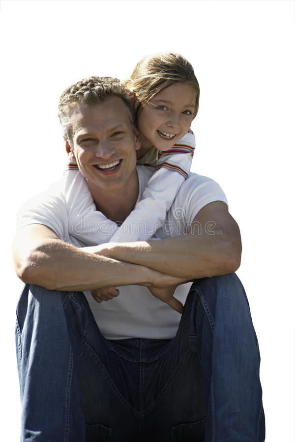 Girl embracing father, smiling, front view, portrait, cut out.  stock image