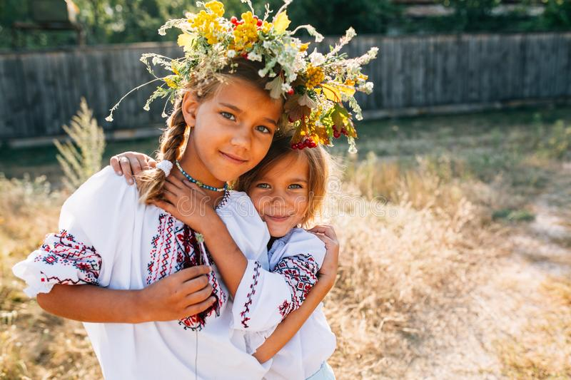 The girl in the embroidered and wreathed smiles. stock images