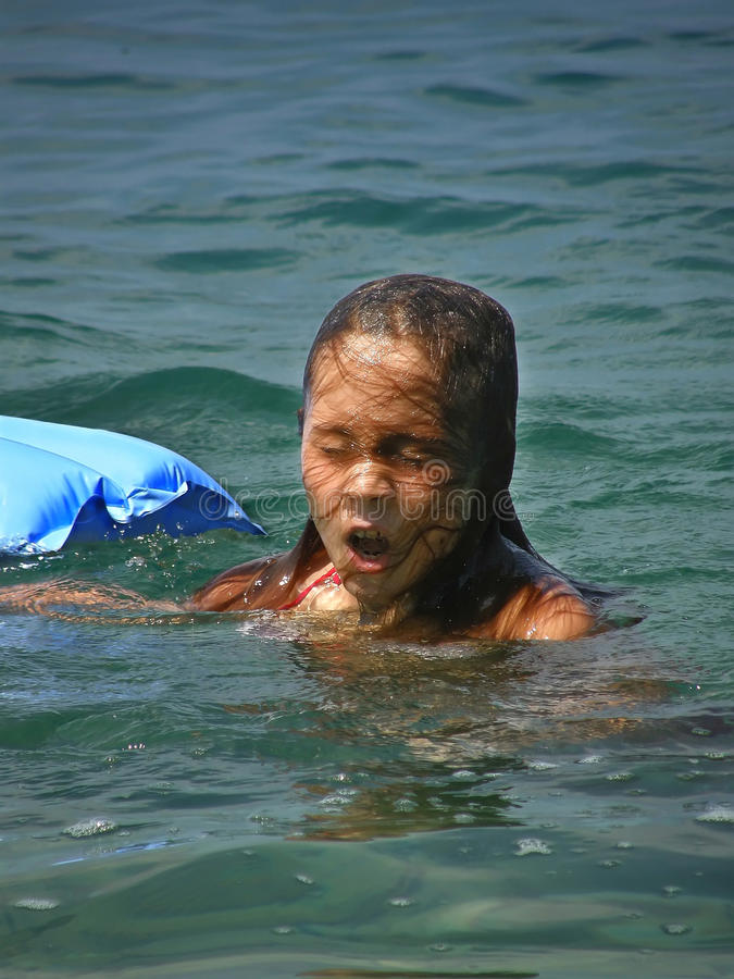 Girl emerges from the sea. Portrait of a girl with unusual hairstyle after emerges - inhaled the air from the Adriatic sea (Croatia-Dalmatia-Mediterranean) royalty free stock photo
