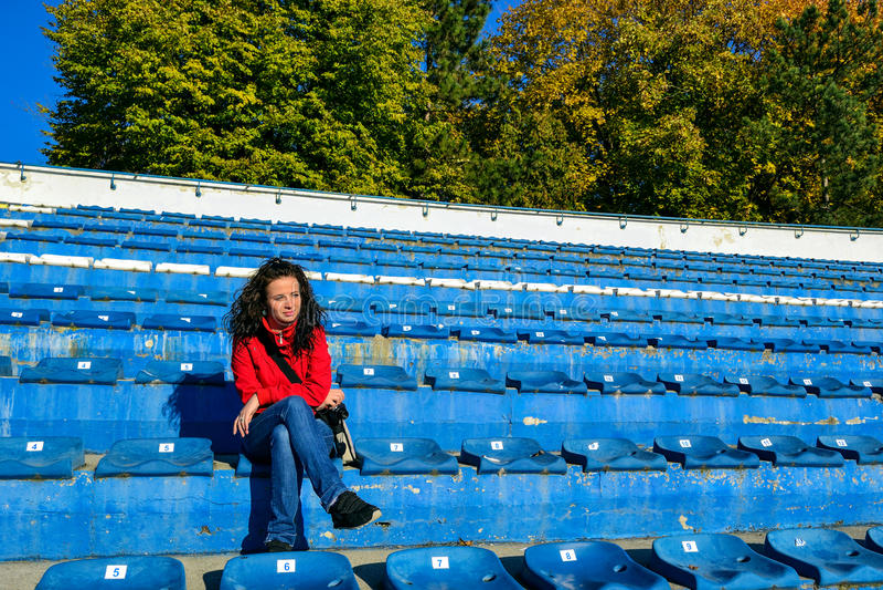 Girl on Empty Stadium royalty free stock photo