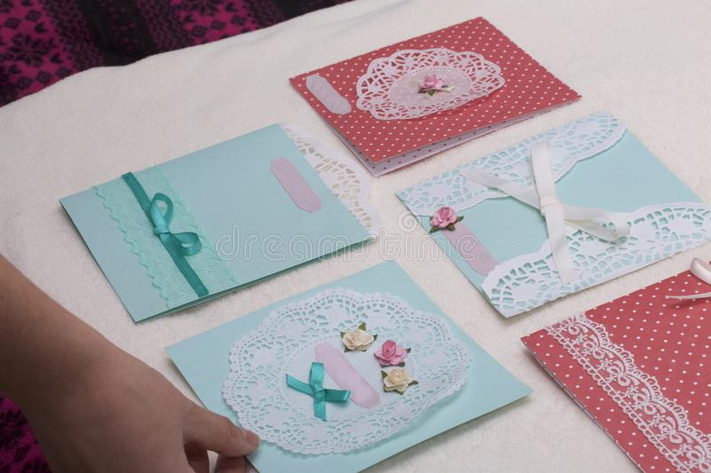 The girl is engaged in making greeting cards at home using paper download the girl is engaged in making greeting cards at home using paper lace m4hsunfo