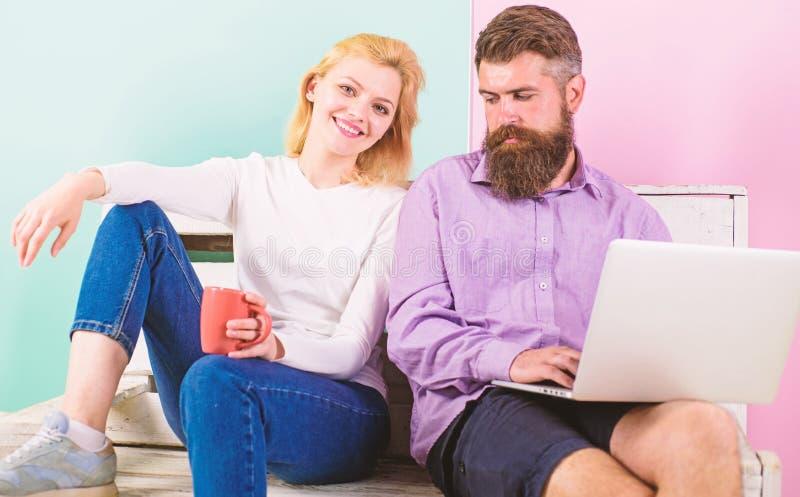 Girl enjoy drink while husband freelancer works with laptop. Freelance benefits. Man works as internet technologies stock photo