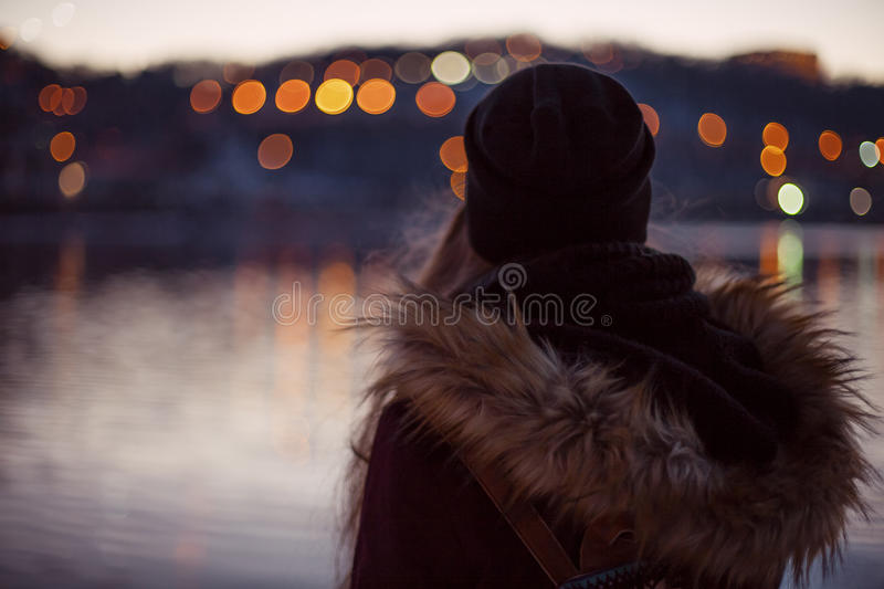 Girl enjoying view of the evening city royalty free stock photos
