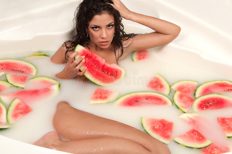 Download Girl Enjoys A Bath With Milk And Watermelon. Stock Image - Image: 32459131