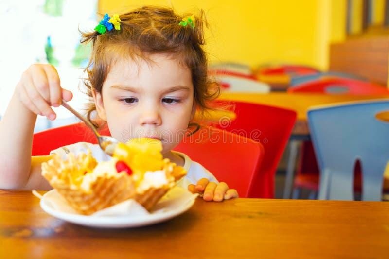 Girl enjoys an ice cream royalty free stock photos
