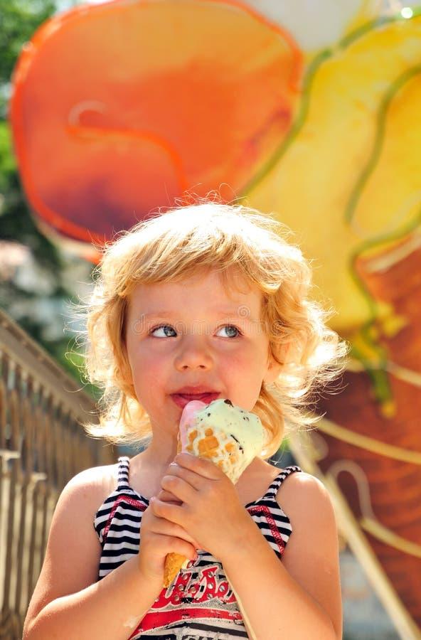 Girl enjoys an ice-cream stock photos
