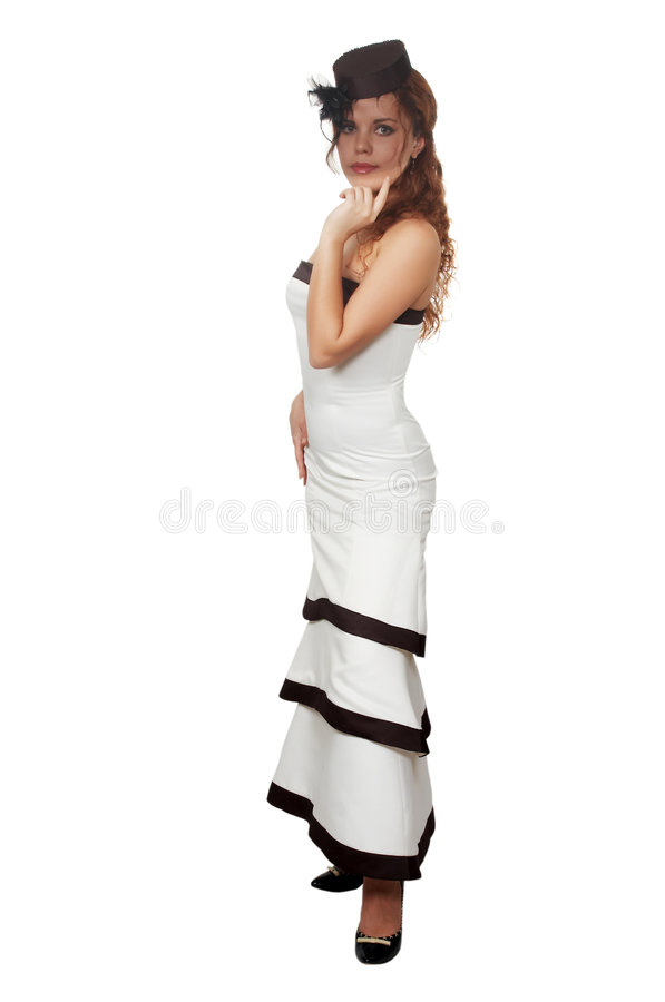 Girl in an evening dress. The young beautiful girl in a white smart evening dress stock photography