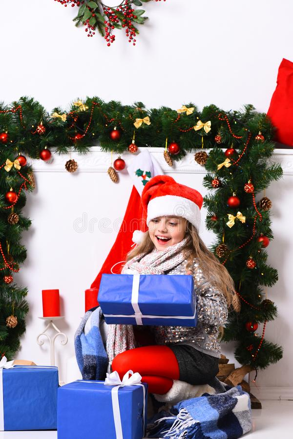 Girl with excited face on white background. Miss Santa royalty free stock photos