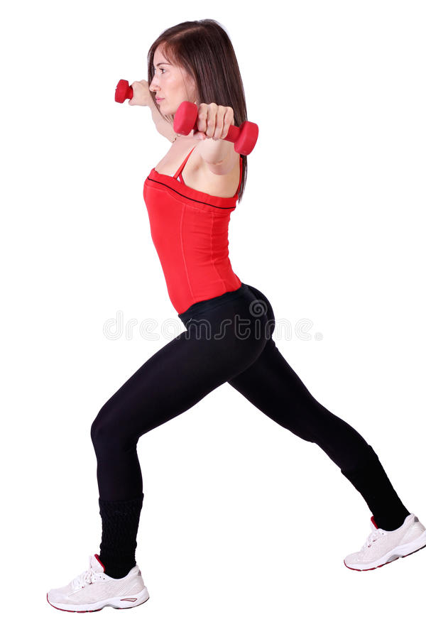 Girl exercise with dumbbells