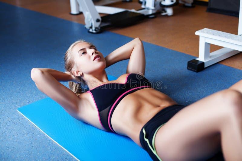 Girl exercising abs royalty free stock photos