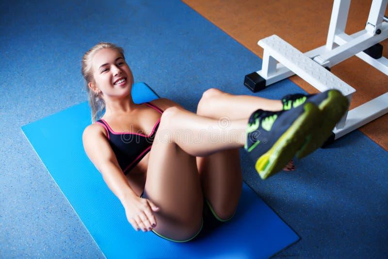 Girl exercising abs stock photography
