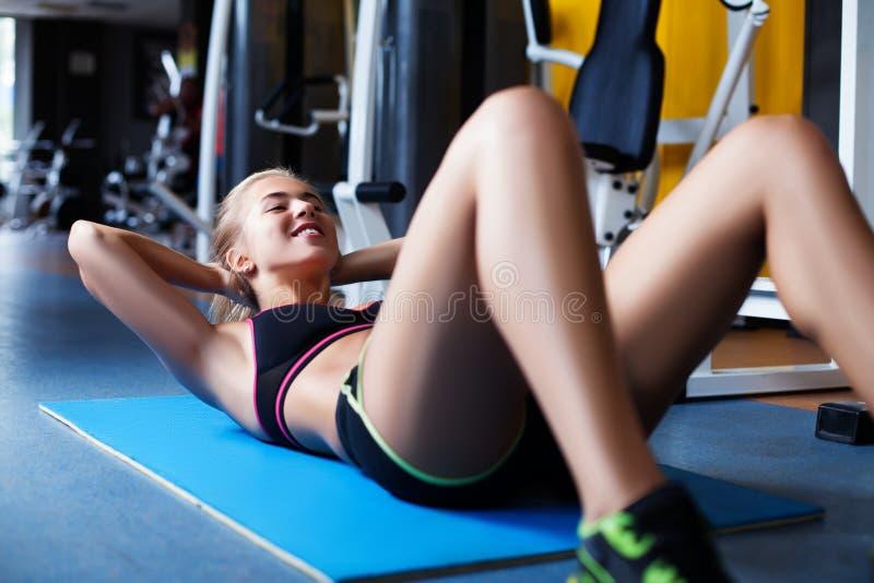 Girl exercising abs royalty free stock photo