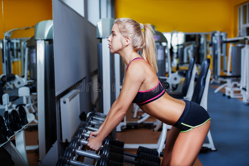 Girl exercising with dumbbell royalty free stock photos