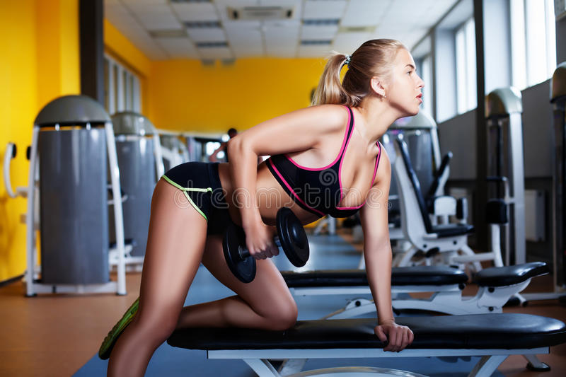 Girl exercising with dumbbell royalty free stock image