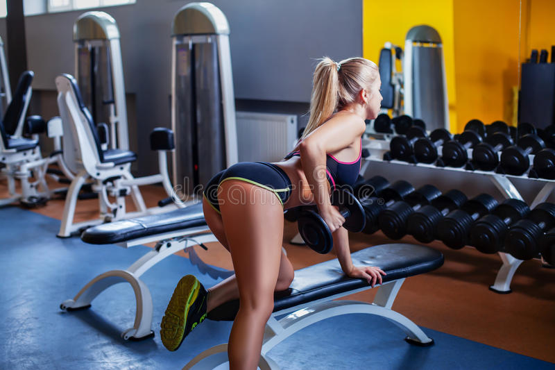 Girl exercising with dumbbell stock photos