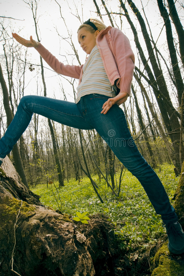 Girl exercising in the forest royalty free stock image