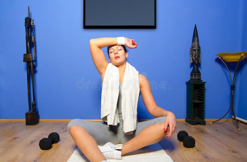 Girl exercising at home stock image
