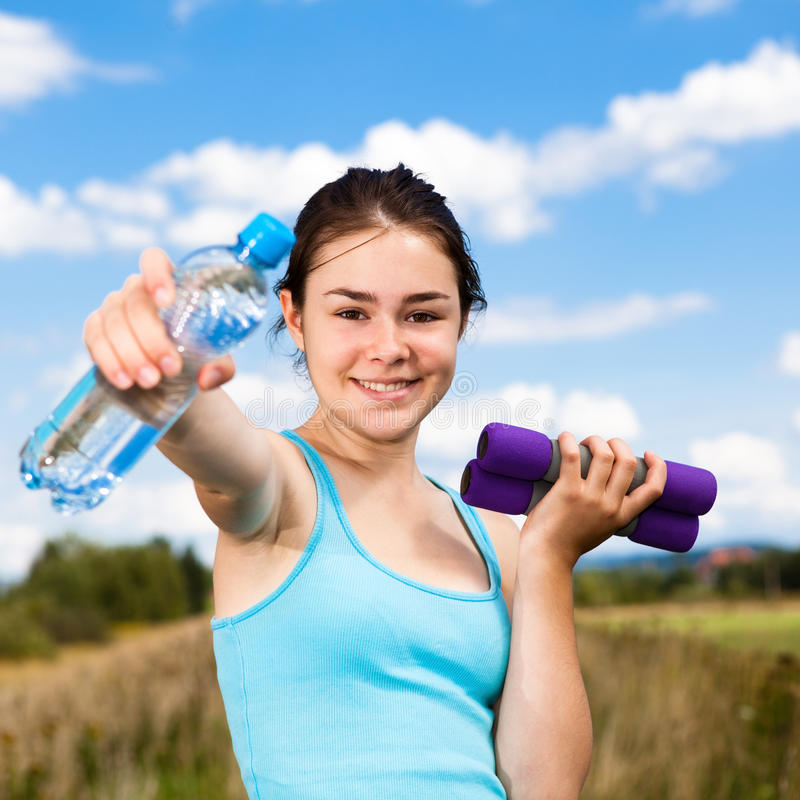 Girl exercising outdoor stock images