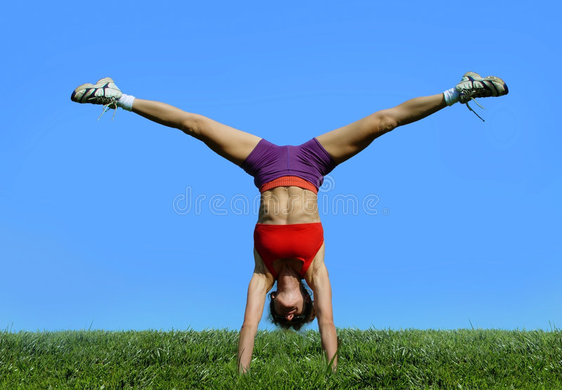 Girl exercising outdoors royalty free stock images