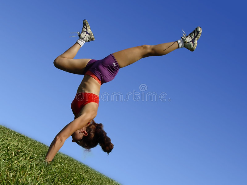 Girl exercising outdoors stock photo