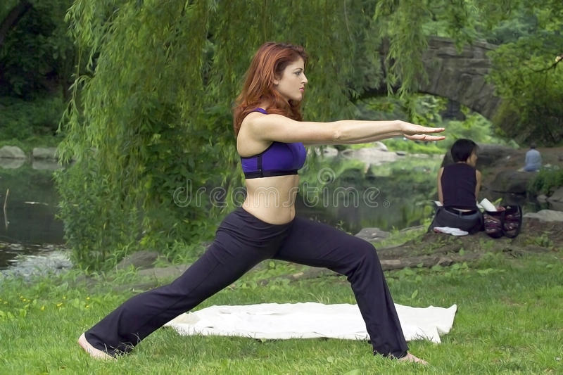 Girl exercising in park stock images