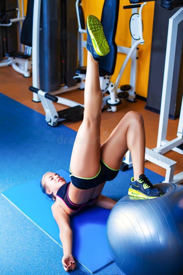 Girl exercising using rubber ball stock image