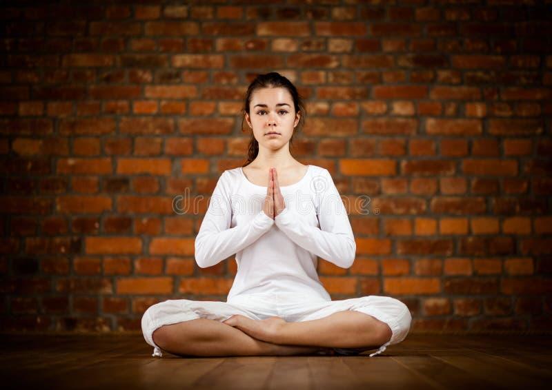 Download Girl Exercising Yoga Against Brick Wall Stock Image - Image: 27054849
