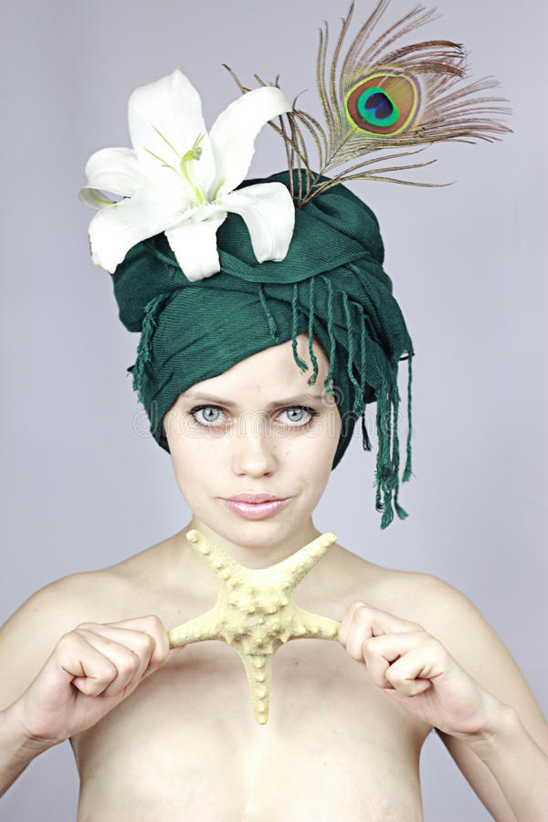 Girl in an exotic cap stock photography