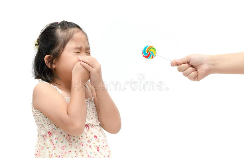 Girl with expression of disgust against candy and suffering from stock photos